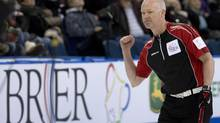 In this file photo Ontario skip Glenn Howard celebrates in Edmonton, Alta. Thursday, March 7, 2013. (JONATHAN HAYWARD/THE CANADIAN PRESS)