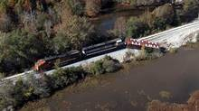 A car lies derailed from a train carrying crude oil in Aliceville, in western Alabama, early November 8, 2013. (WBMA/abc3340.com/REUTERS)