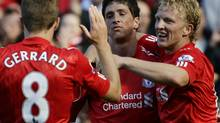 Liverpool's Spanish Fernando Torres (C) celebrates scoring his goal against West Bromwich Albion wth Liverpool's Dutch Dirk Kuyt (R) and Liverpool's Steven Gerrard during a Premier League match at Anfield stadium in Liverpool, north west England on August 29, 2010. Getty Images/IAN KINGTON (IAN KINGTON)