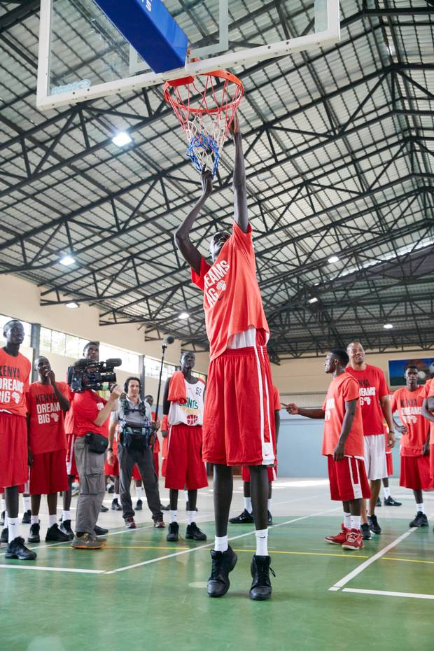 Simon Majur Mabior, age 16, can touch the rim without leaving the ground, a skill that draws a crowd at the Giants of Africa basketball camp in Nairobi.