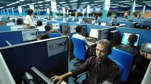 Photo taken on October 30, 2007 shows Filipino call center personnel attending to their US clients at a new business process outsourcing office in Manila. (ROMEO GACAD/AFP/Getty Images)
