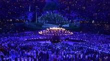 The Olympic Flame is lit during the opening ceremony of the London 2012 Olympic Games on July 27, 2012. (Dylan Martinez/REUTERS)