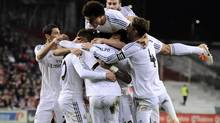 Real Madrid's players celebrate a goal during their Spanish League soccer match between Athletic Bilbao and Real Madrid, at San Mames stadium in Bilbao, Spain, Sunday, Feb. 2, 2014. (Alvaro Barrientos/AP)