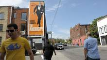A billboard on the side of a building near the corner of Queen St. West and Peter St. in downtown Toronto promotes a film, The American. (Fred Lum/Fred Lum/The Globe and Mail)