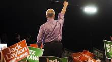 NDP Leader Jack Layton raises his cane to the crowd at a campaign rally in Burnaby, B.C. on Saturday, April 30, 2011. (Andrew Vaughan/ The Canadian Press/Andrew Vaughan/ The Canadian Press)