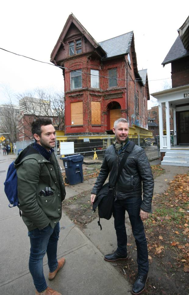 Left, Daniel Lewis and right, Scott Weir, ERA Architects, at the Howard Street house move.