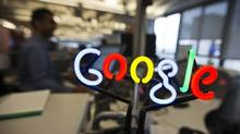 A neon Google logo is seen as employees work at the Google office in Toronto. (Mark Blinch/Reuters)