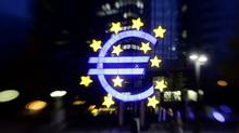 The illuminated euro sign is seen in front of the headquarters of the European Central Bank (ECB) in Frankfurt in this April 5, 2011, file photograph. (KAI PFAFFENBACH/KAI PFAFFENBACH/REUTERS)