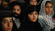 Afghan female students listen to Afghan President Hamid Karzai speak during a graduation ceremony of university students in Kabul on September 13, 2011. The status of women in Afghanistan has changed since the Taliban regime, when women were forced to wear the burqa in public. (SHAH MARAI/SHAH MARAI/AFP/GETTY IMAGES)