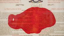 A red paint mark is seen on the Proclamation of the Constitution Act of 1982 at Library and Archives Canada Preservation Centre in Gatineau, Quebec. (Dave Chan for The Globe and Mail/Dave Chan for The Globe and Mail)