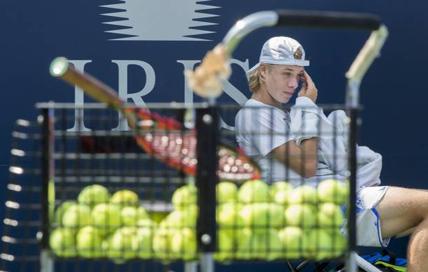 Denis Shapovalov takes a break during a training session as he prepares for the upcoming U.S. Open, Thursday, August 17, 2017 in Montreal. THE CANADIAN PRESS/Paul Chiasson