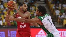 Canada's Cory Joseph,left, looks to pass under pressure from Mexico's Jorge Gutierrez during a FIBA World Cup qualifying basketball game in Caracas, Venezuela, Thursday, Sept. 5, 2013. (Juan Carlos Solorzano/AP)