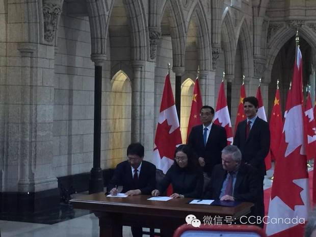 Tianzhou Deng, bottom left, at a signing ceremony with Chinese Premier Li Keqiang and Prime Minister Justin Trudeau behind.