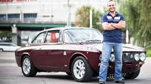 Toronto restaurateur David Minicucci smiles in front of his 1973 Alfa Romeo 2000 GTV. (RICK O'BRIEN/COURTESY OF DAVID MINICUCCI)