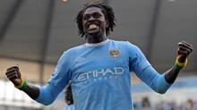 Manchester City striker Emmanuel Abebayor celebrates after scoring for his new club after signing from Arsenal in the close-season. (ANDREW YATES)