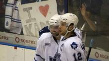 Toronto Marlies' Nazem Kadri, right, celebrates his third period goal against the Abbotsford Heat along with teammate Ryan Hamilton during American Hockey League playoff action at Ricoh Coliseum in Toronto, Ont. Thursday, May 3/2012. (Kevin Van Paassen/The Globe and Mail)