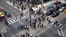 Scramble pedestrian crossing at the intersection of Dundas and Yonge Street in downtown Toronto. (2011 File photo) (Moe Doiron/The Globe and Mail)