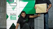 BufferBox's Jay Shah (left) and Aditya Bali show just how much their lockers hold (Naomi Harris)