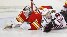 Chicago Blackhawks' Andrew Shaw (R) collides with Calgary Flames' goalie Miikka Kiprusoff during the first period of their NHL game in Calgary, Alberta, February 2, 2013. (TODD KOROL/REUTERS)