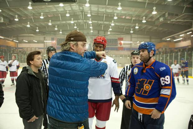 Director Michael Dowse actors Seann William Scott (right) and George Laraque work on a scene from GOON.