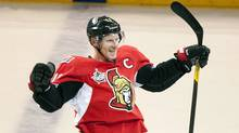 Ottawa Senators' Daniel Alfredsson celebrates after scoring the game winning goal in a shootout against the Minnesota Wild during NHL action in Ottawa Tuesday October 11, 2011. (Adrian Wyld/THE CANADIAN PRESS)