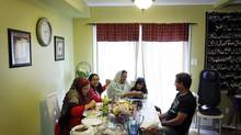 Farina Siddiqui, left, shown having dinner with her daughter Hafsa, mother Rehana Shamim, daughter Iqra and husband Sohail Siddiqui at their home in Mississauga, sees the multi-generational family as the ideal model of living. (Fernando Morales/The Globe and Mail)