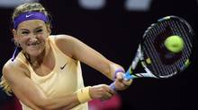 Belarus Victoria Azarenka returns the ball during her match against Romina Oprandi of Switzerland on the Third day of the WTA Qatar Ladies Open in Doha, Qatar, Wednesday, Feb. 13, 2013. (Osama Faisal/AP)
