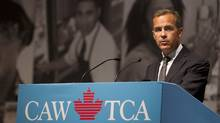 Mark Carney, the head of the Bank of Canada addresses the annual convention of the Canadian Auto Workers Union in Toronto on August 22, 2012. CAW president Ken Lewenza thanked Carney for making this unprecedented visit, and after presenting Carney with a personal gift of thanks, also handed him a copy of the CAW's vision for Canada. (Peter Power/The Globe and Mail)
