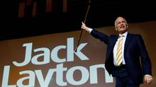 NDP Leader Jack Layton raises his cane as he takes to the stage to deliver his keynote speech to the party's 50th anniversary convention in Vancouver on Sunday June 19, 2011. (DARRYL DYCK/THE CANADIAN PRESS)