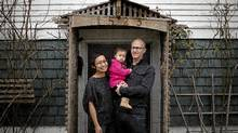 New Westminster, B.C., residents Robin Glover and Bernadette Amiscaray, pictured with 14 month-old daughter Gwyneth, have opted to go the DIY route with their portfolio. (Rafal Gerszak/Rafal Gerszak for The Globe and)