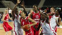 Canada's Miranda Joy Ayim goes for a basket against Mali's Aminata Traore (L) and Farima Toure (R) during their 2012 women's FIBA Olympic Qualifying Tournament in Ankara June 25, 2012. (UMIT BEKTAS/REUTERS)