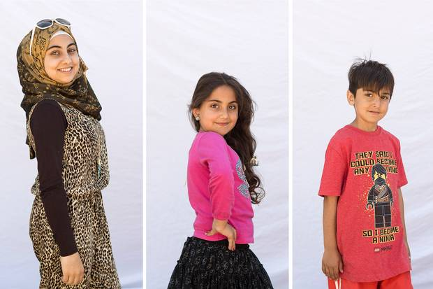 Top: Omer Suleyman and Aliye El Huseyin. Bottom: The Suleyman children, from left, are Esra, 13, Marem, 9, and Suleyman, 7.