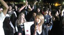 Naomi Klein speaks to a crowd at Allan Gardens during a G20 protest Friday night. (Amit Shilton/The Globe and Mail)