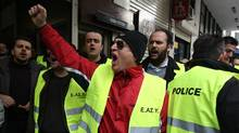 Police unionists shout slogans during an occupation of their social security fund building in Athens, Wednesday, March 7, 2012. (Thanassis Stavrakis/Thanassis Stavrakis/AP)