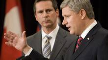 Canadian Prime Minister Stephen Harper, right, and Ontario Premier Dalton McGuinty answer questions at a news conference in Toronto June 1, 2009. (FRED THORNHILL/REUTERS)