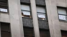 A sign hangs in the windows of the Chicago Board of Trade building that overlooks Occupy Chicago demonstrators (Scott Olson/2011 Getty Images)