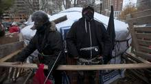 Occupy rotesters chain themselves to the library yurt in St. James Park in Toronto Nov. 21, 2011. (REUTERS)