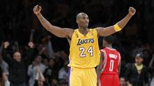 Los Angeles Lakers' Kobe Bryant celebrates their win against the Houston Rockets during the second half of their NBA basketball game in Los Angeles, California October 26, 2010. (LUCY NICHOLSON)
