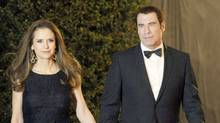 John Travolta, right, and his wife Kelly Preston (Chris Pizzello/AP)