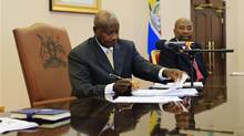 Uganda President Yoweri Museveni signs an anti-homosexual bill into law at the state house in Entebbe on Feb. 24. (JAMES AKENA/REUTERS)
