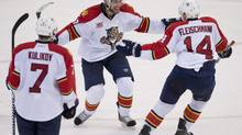 Florida Panthers defenceman Tom Gilbert (left) celebrates his game winning goal with Tomas Fleischmann during third period NHL action against the Ottawa Senators Thursday December 19, 2013 in Ottawa. The Panthers defeated the Senators 4-2. (ADRIAN WYLDE/THE CANADIAN PRESS)