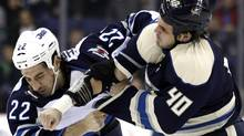 Winnipeg Jets' Chris Thorburn (L) fights with Columbus Blue Jackets' Jared Boll during the second period of their NHL hockey game in Columbus, Ohio November 12, 2011. REUTERS/Matt Sullivan (Matt Sullivan/Reuters)