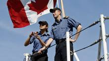 Sailors chat aboard the deck of HMCS Regina at CFB Esquimalt, near Victoria, on Aug. 15, 2011. (Chad Hipolito for The Globe and Mail)