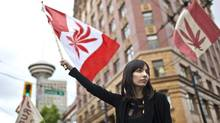Jodie Emery, seen here at a marijuana protest in Vancouver in 2010, is seeking the federal Liberal nomination for Vancouver East, an riding that has been held by the NDP since 1997. (Brett Beadle For The Globe and Mail)