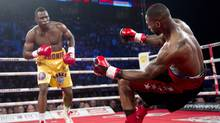 Chad Dawson from the United States, right, is knocked out by Adonis Stevenson from Canada during their WBC light-heavyweight championship bout in Montreal, Saturday, June 8, 2013. (CP)