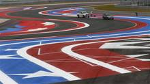 Workers paint a design on the Circuit of the Americas auto racing track (Eric Gay/The Associated Press)