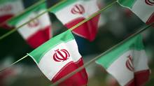Iran's national flags are seen on a square in Tehran February 10, 2012 (Morteza Nikoubazl/REUTERS)