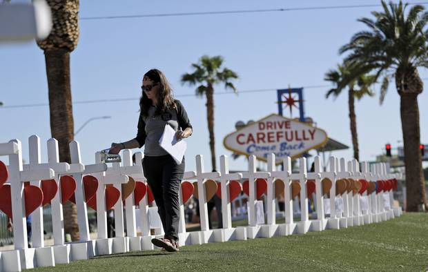 Sherri Camperchioli helps set up some of the crosses that arrived in Las Vegas today to honour the victims of the mass shooting.
