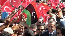 Turkey's Prime Minister Tayyip Erdogan greets people upon his arrival at a rally at Martyrs' Square in Tripoli Sept. 16, 2011. (Suhaib Salem/Reuters/Suhaib Salem/Reuters)