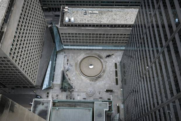 The courtyard of Toronto's Commerce Court in its current state (above) and reimagined by Hariri Pontarini Architects (below).
